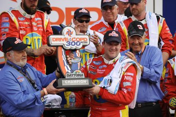Feb 23, 2013; Daytona Beach, FL, USA; NASCAR Nationwide Series driver Tony Stewart celebrates in victory lane after winning the DRIVE4COPD 300 at Daytona International Speedway. Mandatory Credit: Kevin Liles-USA TODAY Sports